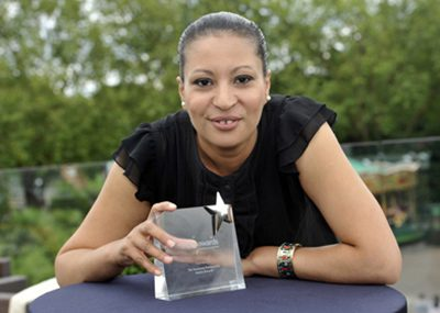 An Aspire Awards winner with her trophy