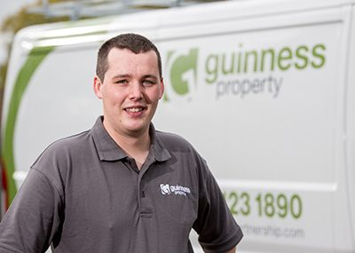 A Guinness operative in front of a repairs van