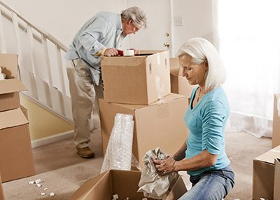 older couple packing up moving boxes
